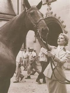 Grace Kelly. Been looking for a picture of her with a horse FOREVER!!!