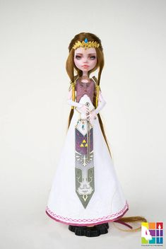 Zelda comes with: A compete face up Rerooted with premium nylon hair She is wearing a beautifully made deluxe outfit with a crown and hair piece A sword A pair of shoes Monster High Doll, Draculaura, has been custom repainted by me. Her original face has been removed carefully. Her