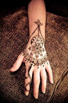 overhead black hand henna tatto design