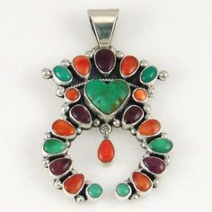 Pendant | Dee Nez (Navajo). Sterling silver with Turquoise, Spiny Oyster, Sugalite. by odessa