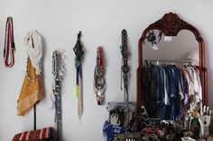 hanging necklaces, mirror & clothes hanging