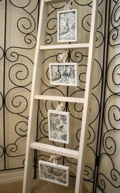 Old ladder to display photos!! Ah saw a thrift shop with ladders I wanted now I know what to do!!