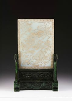 Celadon white jade table screen on spinach green base, Qing Dynasty, late 18th-early 19th century