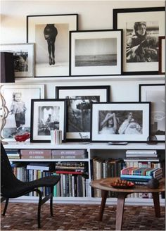 Have a lot of pictures you want to display? Here's a bunch of ways to get them all up on the wall... This is our favourite of the bunch; frames on a ledge.