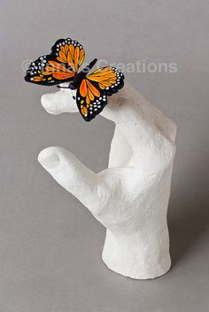 Quilled butterfly on a plaster cast hand by Inna's Creations, via Flickr