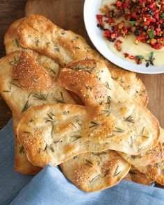 [ Recipe: Herbed Flatbread Crackers ] Made with: warm water, active dry yeast, all-purpose flour, extra-virgin olive oil, coarse salt, sugar, egg, sea salt, and fresh rosemary or thyme (or both!). Can be stored for 3 days at room temp in airtight container. ~ from Martha Stewart Recipes
