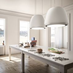EDITH kitchen hood from Elica. The new edition of Evolution, the first chandelier hoods collection launched in the world by Elica in 2005 , relaunched for 2014. Designed by FABRIZIO CRISÀ.