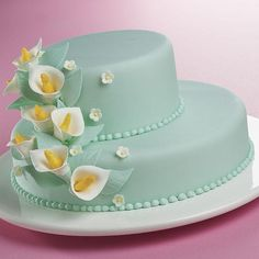 Lily Legend Cake - It's a striking contrast of colors, as white calla lilies ascend to the top of green fondant tiers. What a great feeling to know that your Gum Paste and Fondant Course experience makes amazing cakes like this possible!