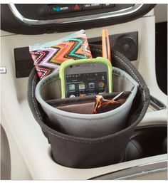 Auto Storage - Compartment Console provides convenient storage for your media devices sunglasses and other travel accessories. It fits in most car cups.