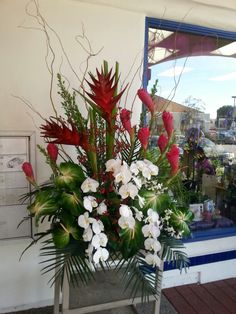Tropical flower arrangement red white and green for wedding and event