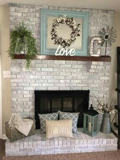 homey ideas fireplace designs. Love this cotton wreath against a mirror for an extra pop of color  gray brick fireplace with cozy accents Fireplace Makeover Before And After Brass screen Brown