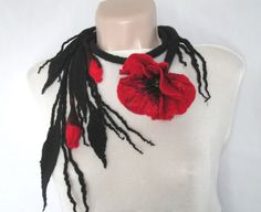Romantic and elegant handmade Poppy Necklace ,felted from soft and cosy Merino Wool(the poppy has reflexes wit silk).It can be wear also as a belt. 100% handmade. The necklace ( belt) has a circumference around 105 cm. Weight 34 g.   Care You don't need to wash felt often as wool has a self-cleaning quality. It is enough to ventilate an item in fresh air,and protect it from dust.However, if you decided to wash it, do it by hand in water at less then 30 deg It is resistant to moisture and…