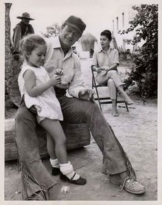 ~ John Wayne with his daughter and wife Pilar. ~
