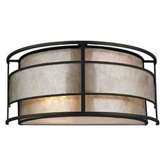 This sconce blends styles to create the right look to blend with any decors. Design Classics Lighting Mica Shade Wall Sconce | 1683 TB | Destination Lighting
