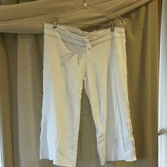 White raw edge capri size XL by bija These white with grey stitching capri are great for lounging  around with friends or at home. I only wore a few times. EUC They are an XL but I think they are a bit more like a L. I wore them with the black tee-shirt with white stitching that is also in my closet. There are no stains, rips or tears on these. From a smoke free/pet free home. bija Pants Capris