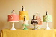 Love the idea of having multiple small cakes on multi level tiers