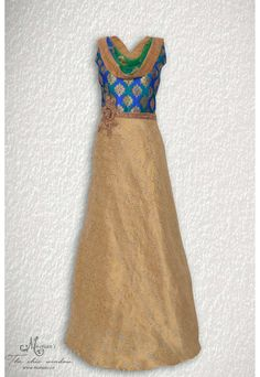 Elegant golden and peacock shaded ensemble adorn in exquisite embroidery at yoke