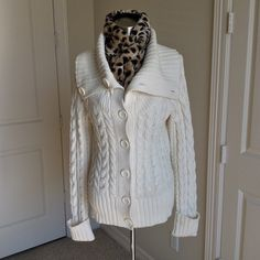 Caslon Beige Sweater - Great for Winter! This thick beige warm sweater includes the following features: 6 button closure, braided design throughout, long sleeves with cuff, wide band neckline (can be worn open or as turtle neck), 60% cotton, 40% acrylic, good condition, Size M Caslon Sweaters Cowl & Turtlenecks