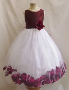The dress is made of high quality satin fabric. The skirt has 4 layers, combination of tulle fabric and soft lining fabric. You are able to choose custom petals color for your dress. We do have more than 20 petals color to match your theme. The accessories (Necklace and Headpiece) are sold separately.    For the single petal color:  https://www.etsy.com/shop/NollaCollection/search?search_query=petal&order=date_desc&view_type=gallery&ref=shop_search    For the multiple petal colors…