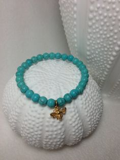 Turquoise Bracelet with Honey Bumble Bee Charm Bracelet. $20.00, via Etsy.