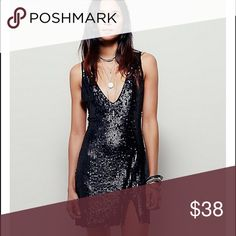 Free people sequin dress in black size small New, never worn. Size small. Black mate sequins. Front split. Beautiful dress Free People Dresses Mini
