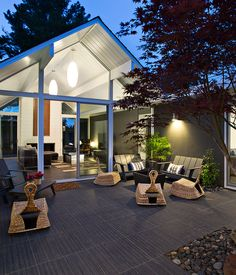 The living area opens beautifully into the outdoor area, which is a key design element of Eichler homes.