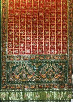 Gharchola Saree GHA1SAR52 TRADITIONAL GHARCHOLA SILK SARI FROM GUJRAT WITH HANDWORK IN ZARI & THREAD Type GHARCHOLA Material SILK Length 5.5 Mtrs Blouse 75 Cms Color RED & GREEN Washing Instruction DRYCLEAN ONLY