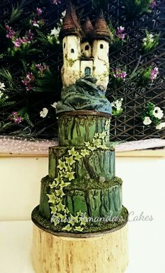 Hand painted fairytale enchanted forest wedding cake with Rice Krispie treat castle by Louise Amanda's Cakes