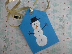 Thumb print snowmen - Christmas crafts for kids - Netmums