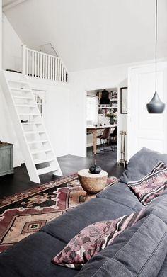 dark floors and white ladder.
