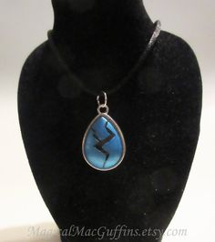 """This pendant was inspired by the original appearance of Lapis Lazuli, from Steven Universe.  The """"gem"""" is a glass cabochon that's been colored"""