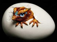 This is the Hatching Kinglet Dragon in silver. Description from windstoneeditions.com. I searched for this on bing.com/images