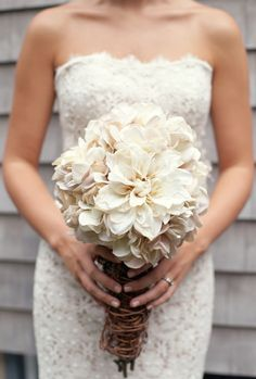 Gorgeous all white bouquet wrapped in twine/twigs.