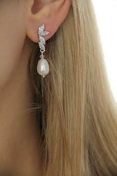 Pretty earrings. This Etsy site has lots of gorgeous wedding jewelry
