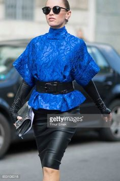 A guest seen wearing a black belt from Givenchy during Milan Fashion Week Spring/Summer 2018 on September 24 2017 in Milan Italy
