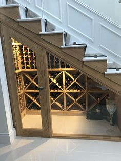 Bespoke wine racking for under stairs wine storage, perfect for any home re-design or makeover! Made from hand in the UK using Pine, this wine cellar can store up to 350 bottles. #WineStorage #wineracks