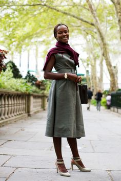 On the Street…. Bryant Park, NYC.  Tossing a brightly colored scarf over a dress is a great way to transition to cooler weather.