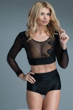 Crop top with long sleeves and applique front. Stretch mesh panels with see thru effect and opaque shoulders.