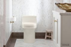 This one-piece San Souci toilet with deodorizing toilet seat offers a sleek, contemporary design paired with a touchless flush.