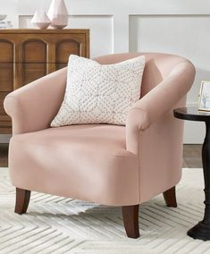 Pretty. Petite. Perfect. Bring beauty and cozy comfort to a bedroom, office, or variety of other spaces. Cora is wonderfully feminine, with sloping, rolled arms; gracefully curving wood feet; and a wraparound back. Surprise: soft, self-fabric throw pillow included. Velvet Accent Chair, Accent Chairs, Furniture Grade Plywood, Leather Club Chairs, Chair And A Half, French Chairs, Beautiful Living Rooms, Mortise And Tenon, Living Room Inspiration