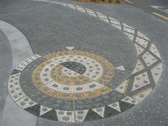 """""""Mamaku Koru"""".  Stone mosaic by John Botica"""