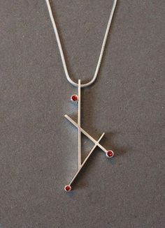 Red sapphire geometric pendant Orange sapphire geometric pendant by GothamAtelier Geometric Jewelry, Modern Jewelry, Metal Jewelry, Pendant Jewelry, Jewelry Art, Men's Jewellery, Bullet Jewelry, Red Jewelry, Designer Jewellery
