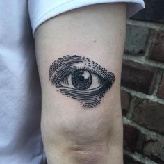 amazing eye tattoo idea on the arm