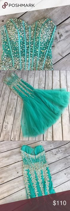 Camille Le Vie Mint Prom Dress Turquoise strapless embellished pageant dress with a mermaid feel. Super beautiful! Beading in the back is loose but the rest is intact. See photos for details Camille La Vie Dresses Prom