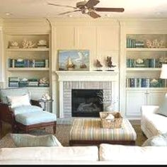 Built-in inspiration for our family room. my husband is someday planning on building me some bookcases in our fireplace this room. this is beautiful!