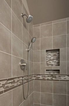 This shower has beautiful neutrals and a splash of bling with the decorative tile liner and built in shampoo niche. Shower fixtures by Hans Grohe ~ http://walkinshowers.org/best-shower-faucet-reviews.html