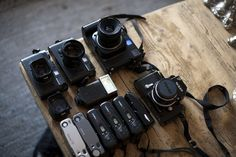 Mamiya 7II, 80mm/f4, Leica M6TTL, 50mm/2, Leica M6, 35mm/2 , 35mm/2, Leica SF 20 flash, 2x contax t2, 3x yashica t4,  1x olympus mju II - ive got 8 of these, 1x Nikon F +nikkor 50mm/1.4, + plus a contax g2 with 28mm, 46mm and 90mm