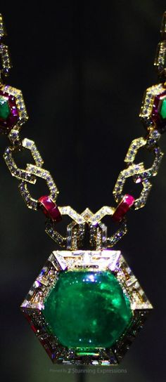 Sautoir in gold with emeralds, rubies and diamonds