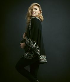 Warming Trend. -- Luxurious capes and wraps for weathering the chill.