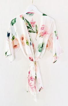 Spring Rose Satin RobeSpring rose satin robes are an ideal gift for bridesmaids, the bride to be or even as a birthday gift! These delicate robes come in a pretty rose floral pattern and are made of soft polyester satin. Each robe comes with a ma Bride Hanger, Wedding Dress Hanger, Gown Wedding, Bridesmaid Hangers, Bridesmaid Gifts, Bridesmaids, Floral Bridesmaid Robes, Bride Dressing Gown, Bridal Party Robes